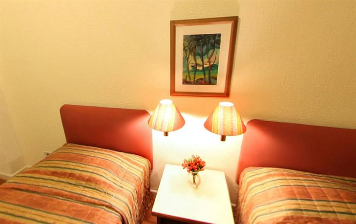 Photo 2 - Rojas All Suite Hotel